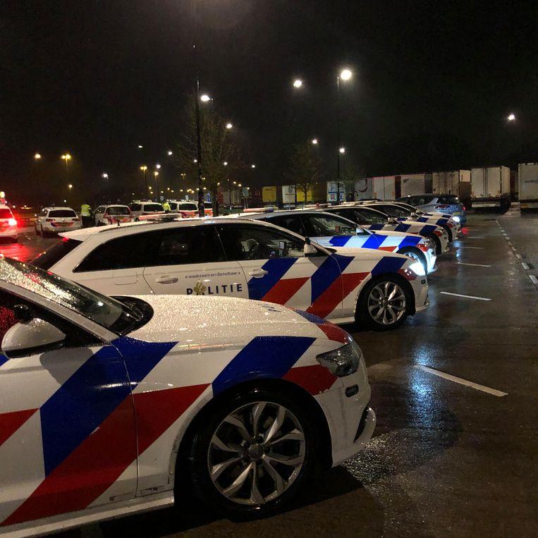 Snelle politiewagens. Beeld Toine Heijmans