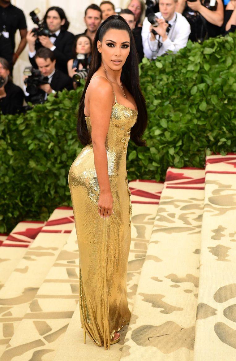 Kim gaat niet echt onopvallend op weg naar het MET Gala in 2018. Beeld Photo News