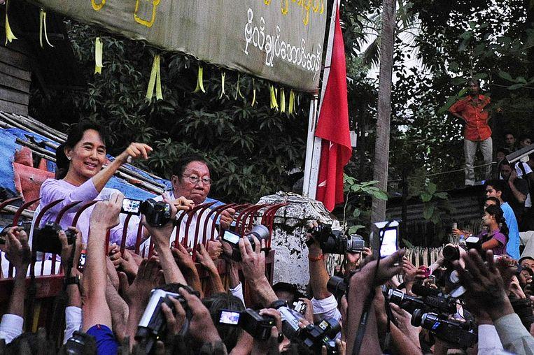 Aung San Suu Kyi in 2010 bij haar vrijlating. Beeld AFP