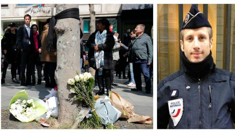 Op de plaats waar Xavier Jugelé werd vermoord, liggen intussen witte bloemen. Een zwarte sjaal, aan een boom geknoopt, herinnert aan een nieuwe zwarte dag die Frankrijk kent. Beeld AP & RV