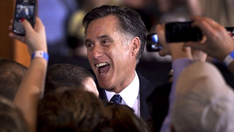 Mitt Romney viert zijn overwinning in Illinois. Beeld ap