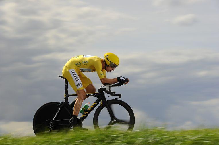 Geletruidrager Bradley Wiggins in actie tijdens de Tour de France 2012, die hij ook zou winnen. Beeld AFP