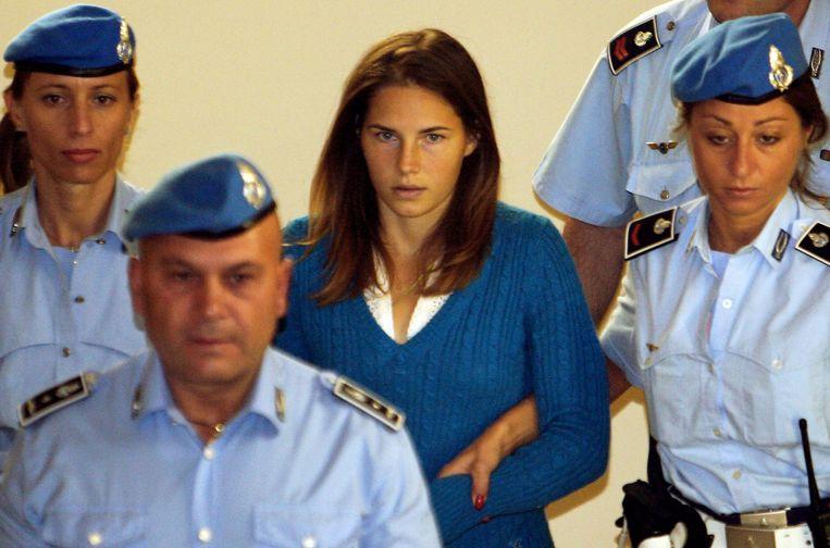 'Toen ik tijdens de ondervragingen werd geslagen, begon ik aan mezelf te twijfelen.' (Foto: op weg naar de rechtbank in september 2008.) Beeld AFP