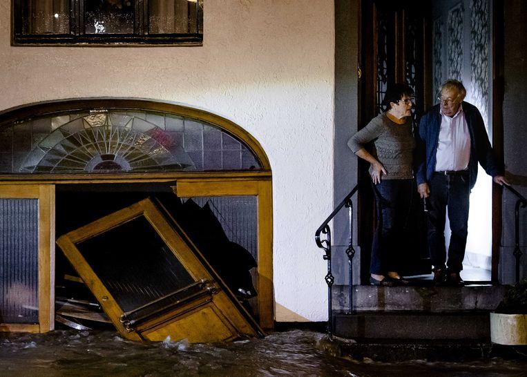 Schade aan een woning door het overstromende water van de Geul in Valkenburg. Beeld ANP