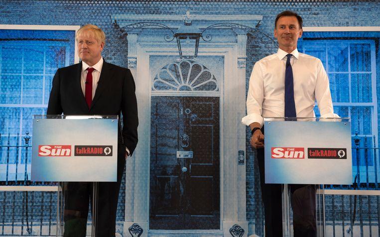 Boris Johnson en Jeremy Hunt nemen in 2019 deel aan een debat van TalkRadio. Beeld Getty Images