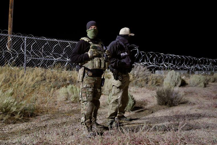 Militairen houden de wacht voor Area 51, voor de zekerheid, na het aangekondigde Facebook-evenement.  Beeld AP