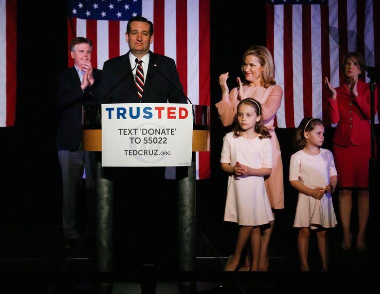 Republikeinse presidentskandidaat Ted Cruz met zijn vrouw Heidi en hun twee dochters. Beeld afp