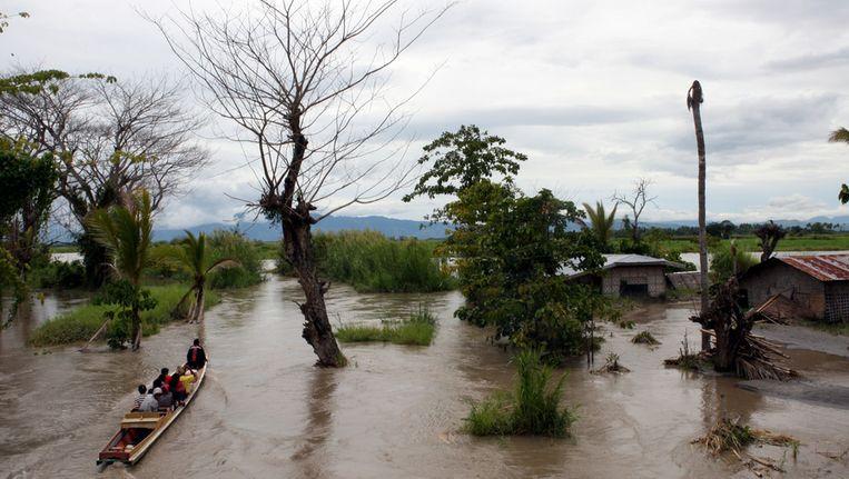 Een overstroomd dorp in de Filipijnen, veroorzaakt door moessonregens. Beeld getty
