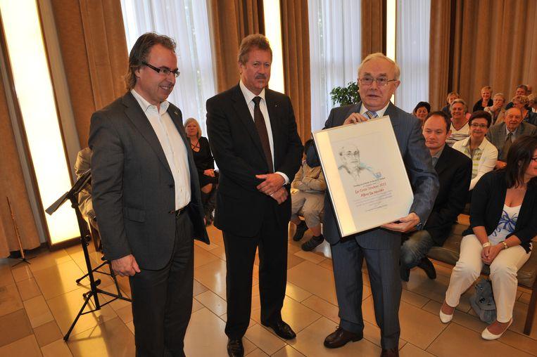Alfons De Meulder, de directeur van de Muziekacademie, won eerder de eretitel.