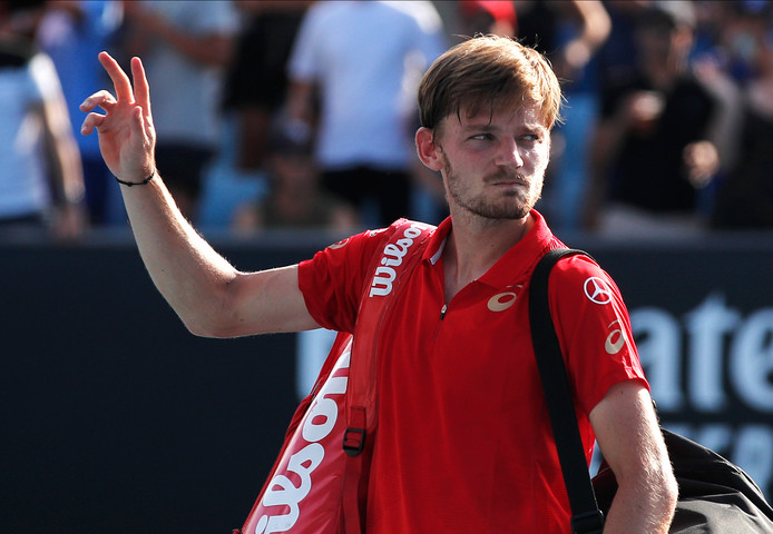 Belgium's David Goffin waves as he walks from the court following his third round loss to Russia's Andrey Rublev at the Australian Open tennis championship in Melbourne, Australia, Saturday, Jan. 25, 2020. (AP Photo/Andy Wong)