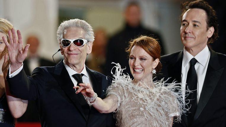 David Cronenberg, Julianne Moore en John Cusack. Beeld epa