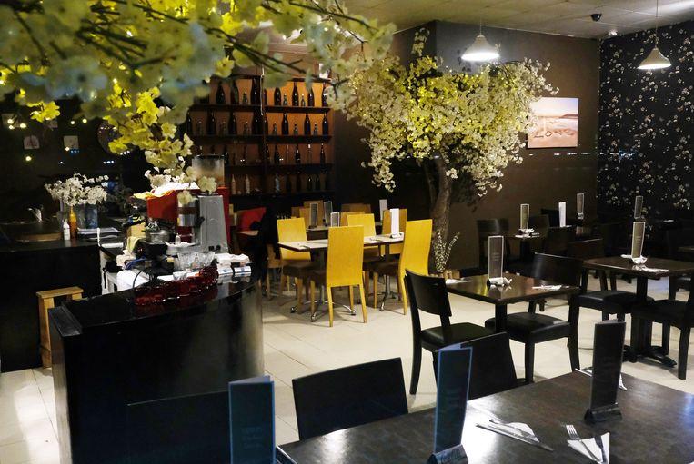 Een leeg restaurant in de Docklands in Londen. Beeld Reuters