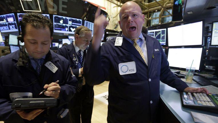 Handelaren op de beursvloer van de New York Stock Exchange. Beeld ap