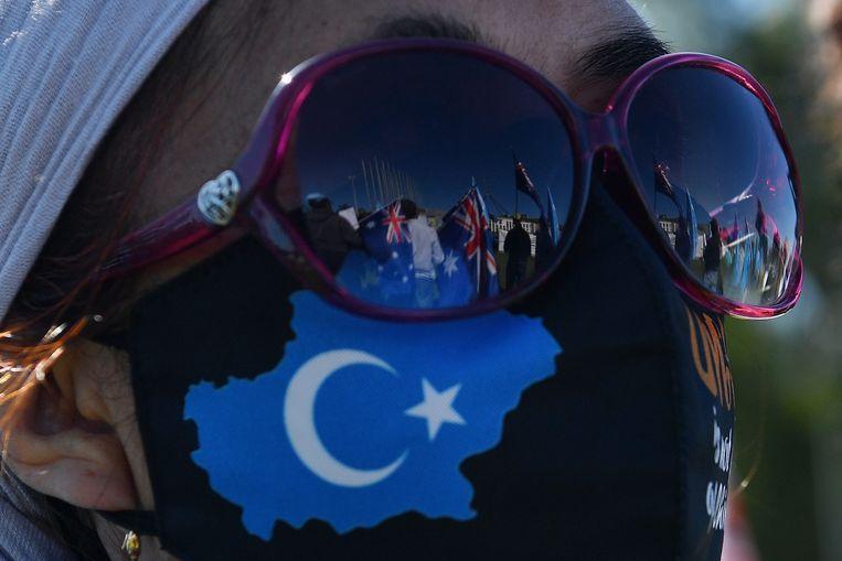 Protesten in Canberra tegen de behandeling van Oeigoeren in China. Beeld Getty