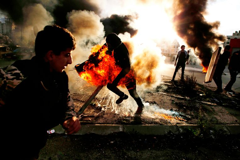 Betogers clashen in Ramallah met Israëlische veiligheidstroepen. Beeld AFP
