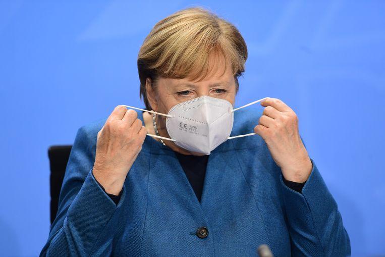 Angela Merkel voorafgaand aan de persconferentie van woensdag.  Beeld EPA