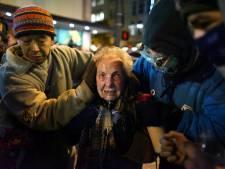 84-jarige ongewild het gezicht van grimmig Occupy-protest