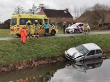 Auto te water in Wageningen, bestuurder gewond