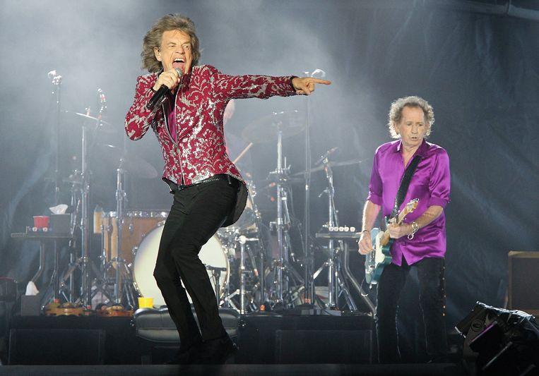Mick Jagger en Keith Richards afgelopen zomer op een Stones-concert in New Jersey. Beeld Photo News