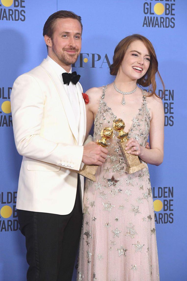 Ryan Gosling en Emma Stone, hoofdrolspelers in La La Land. Beeld afp