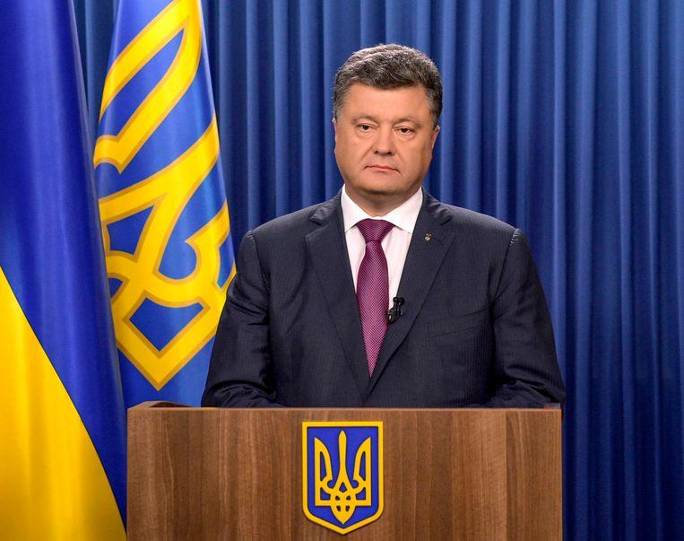 Porosjenko maakte gisteren bekend het parlement te zullen ontbinden. Beeld REUTERS