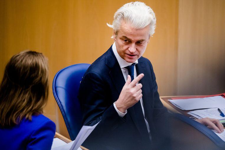 Geert Wilders  en Fleur Agema  tijdens een plenair debat in de Tweede Kamer over de coronavirus.  Beeld Hollandse Hoogte /  ANP
