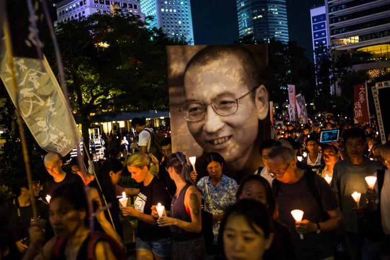 Een protestmars ter ere van Liu Xiaobo. Beeld getty