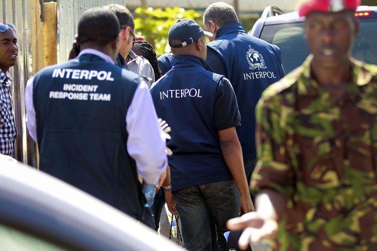 Onderzoekers van Interpol in Nairobi. Beeld EPA
