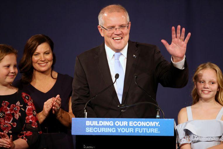 De regerende conservatieve coalitie van premier Scott Morrison heeft een verrassende overwinning geboekt bij de parlementsverkiezingen in Australië.