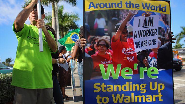 Demonstranten in Florida doen mee aan de 'wereldwijde dag' van actie tegen Walmart. die onder meer wordt gehouden wegens de slechte behandeling van medewerkers. Beeld afp