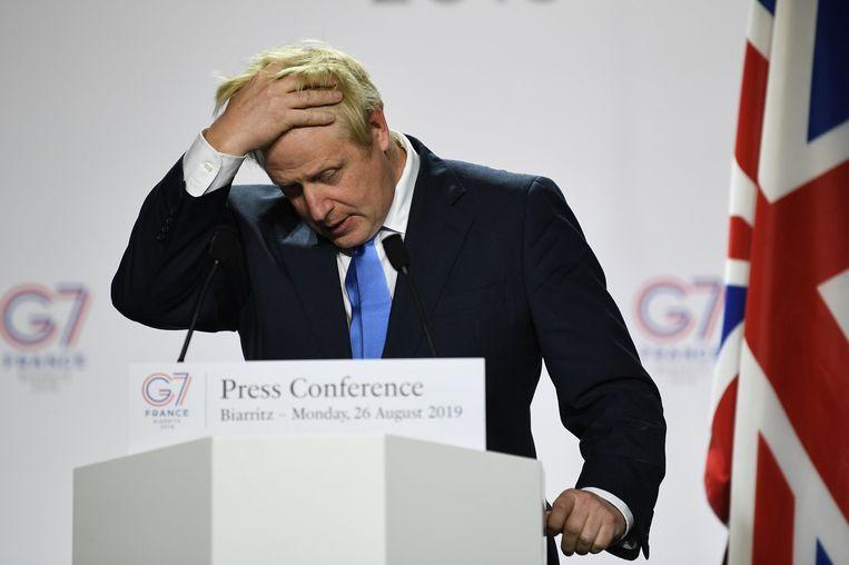 De Britse premier Boris Johnson tijdens een persconferentie gisteren op de G7-top in Biarritz. Beeld Photo News