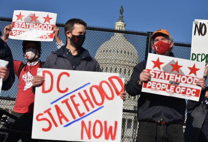Demonstranten aan het Capitool eisen dat Washington DC een aparte staat wordt.
