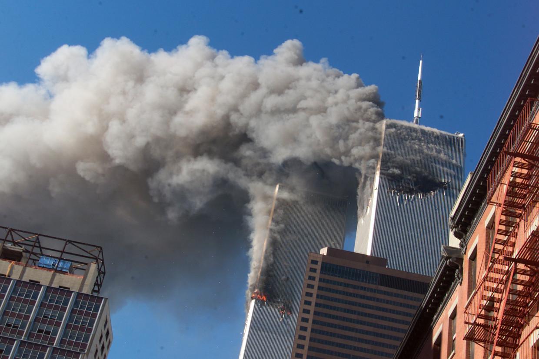 De aanslagen van 11 september 2001 op het World Trade Center. Complottheorieën ontstonden in eerste instantie te linkerzijde. Beeld AP