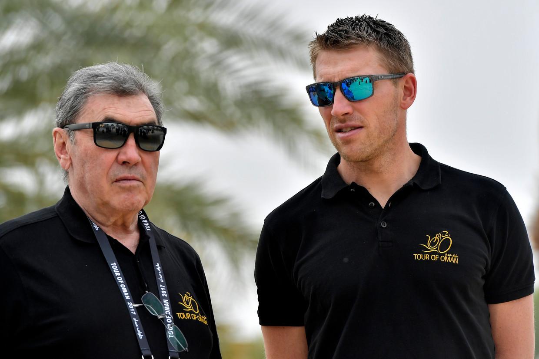 Axel Merckx naast zijn vader Eddy, in 2017. Beeld Photo News