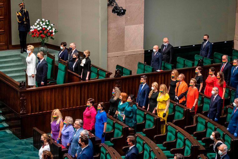 De parlementsleden tijdens de beëdigingsceremonie van president Andrzej Duda. Beeld AFP