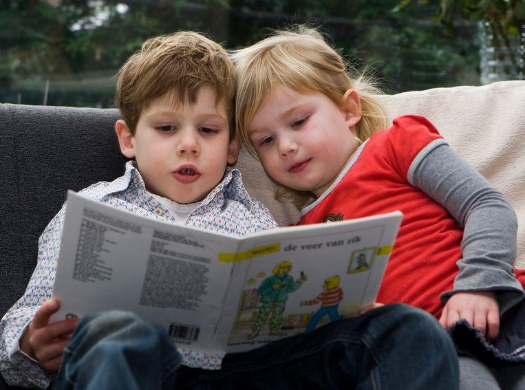 Kinderen lezen tijdens Nationale Voorleesdagen. Beeld ANP XTRA