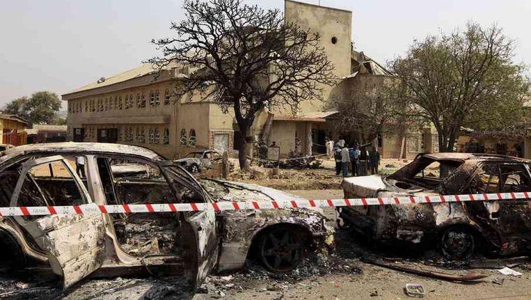 De plek waar in Nigeria waar een autobom ontplofte nabij een katholieke kerk. Beeld reuters