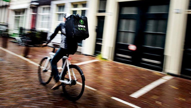 Maaltijdbezorgers zouden een verkeerstraining moeten krijgen Beeld ANP