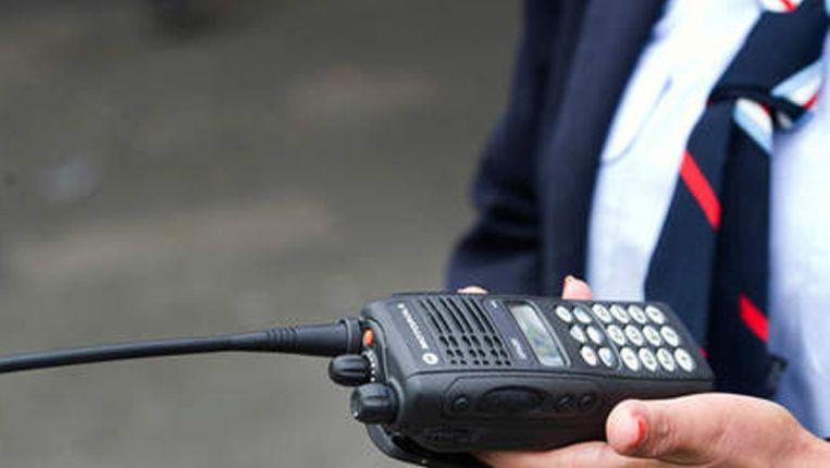 Een RET-medewerker met portofoon. Beeld Archiefbeeld ANP