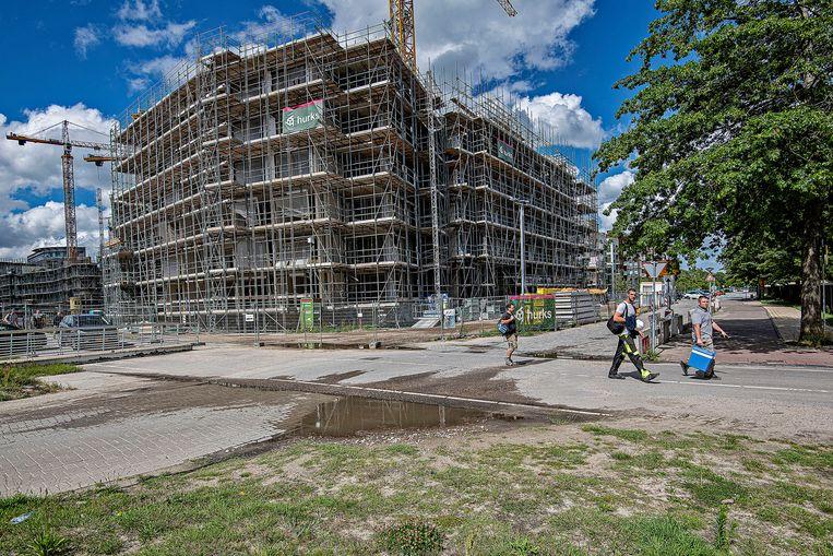 In Amsterdam kwamen er in het afgelopen jaar de meeste woningen bij, zo berekende het CBS: vierduizend stuks.  Beeld Guus Dubbelman / de Volkskrant
