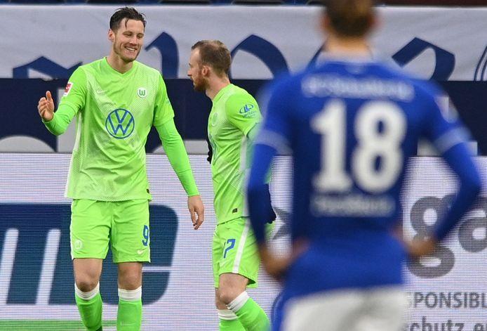 Weghorst (l) na zijn treffer voor Wolfsburg.