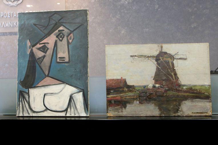 De Griekse politie heeft de schilderijen Hoofd van een vrouw (Picasso, 1939) en Molen (Mondriaan, 1905) teruggevonden.  Beeld EPA