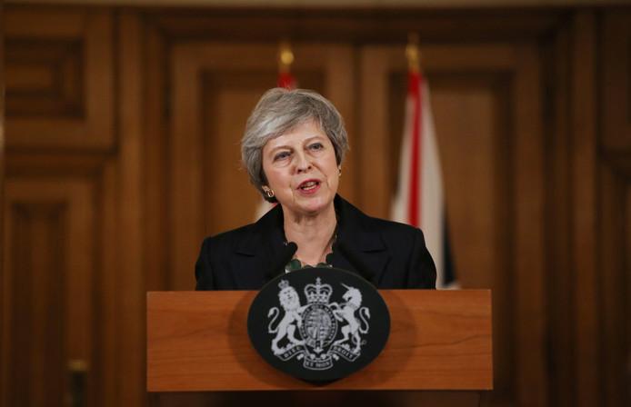 Theresa May tijdens de persconferentie.