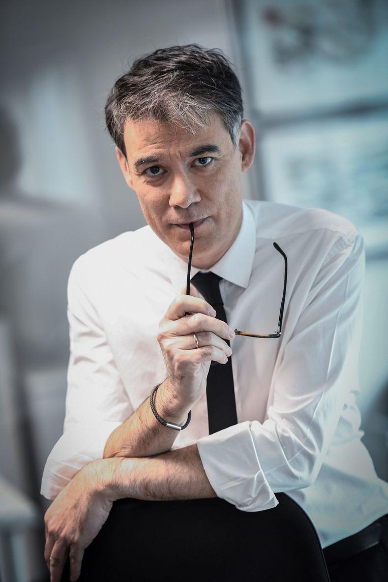 Partijleider Olivier Faure in zijn glazen kantoor. Beeld Stéphane de Sakutin/AFP