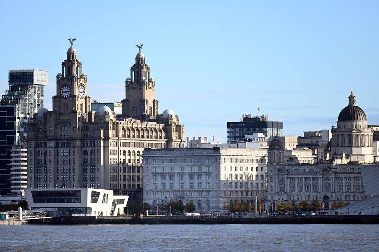 De oude haven in Liverpool. Het gebied is door de  Unesco geschrapt van de Werelderfgoedlijst.  Beeld AFP