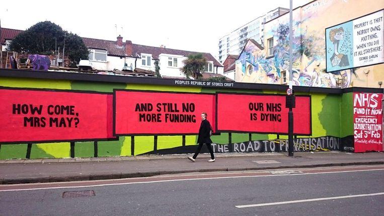 De actiegroepen Protect Our NHS en de People's Republic of Stokes Croft kwamen met het idee voor de muurschildering in Bristol, Verenigd Koninkrijk. Beeld https://prsc.org.uk/