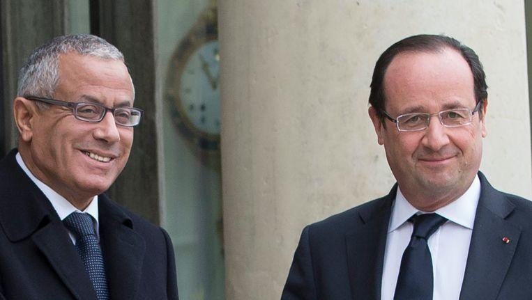 De Libische premier Ali Zeidan (links) met de Franse president François Hollande. Beeld EPA
