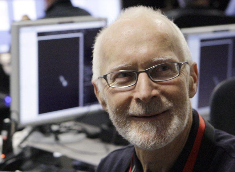 De Brits-Australische sterrenkundige naar wie de komeet genoemd werd, is ook in de wolken. Beeld AP