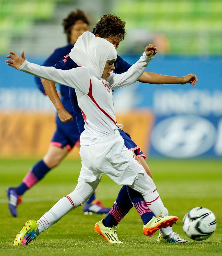 De Jordaanse voetballer Anfal Nayef Hammad Alsufy tijdens een wedstrijd tegen Japan, tijdens het Aziatische kampioenschap voetbal in 2014. Beeld AP