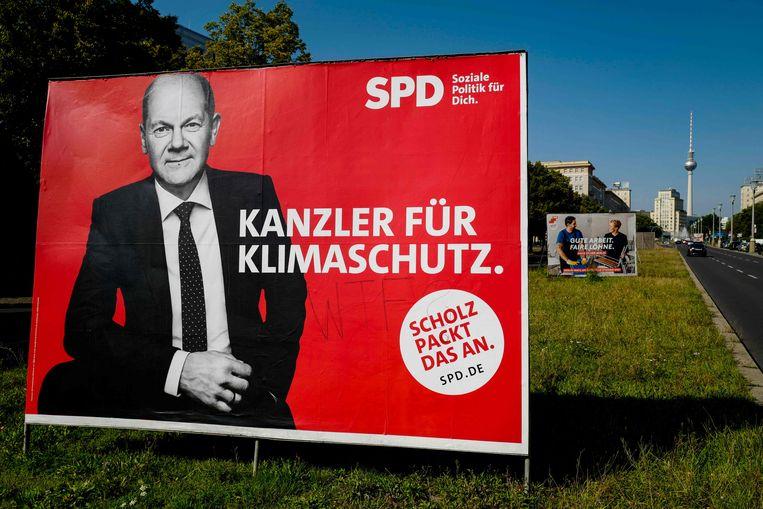 Een verkiezingsaffiche van Scholz. Beeld AFP